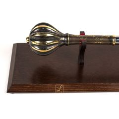 Brass mace on a wooden table, promotion, nomination, honorary award